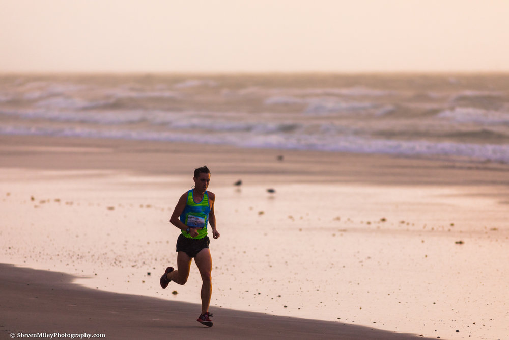 The first runner in the U.S.A. Beach Running Championships half-marathon to pass by while waiting for a Falcon 9 launch. Cocoa Beach, Florida.