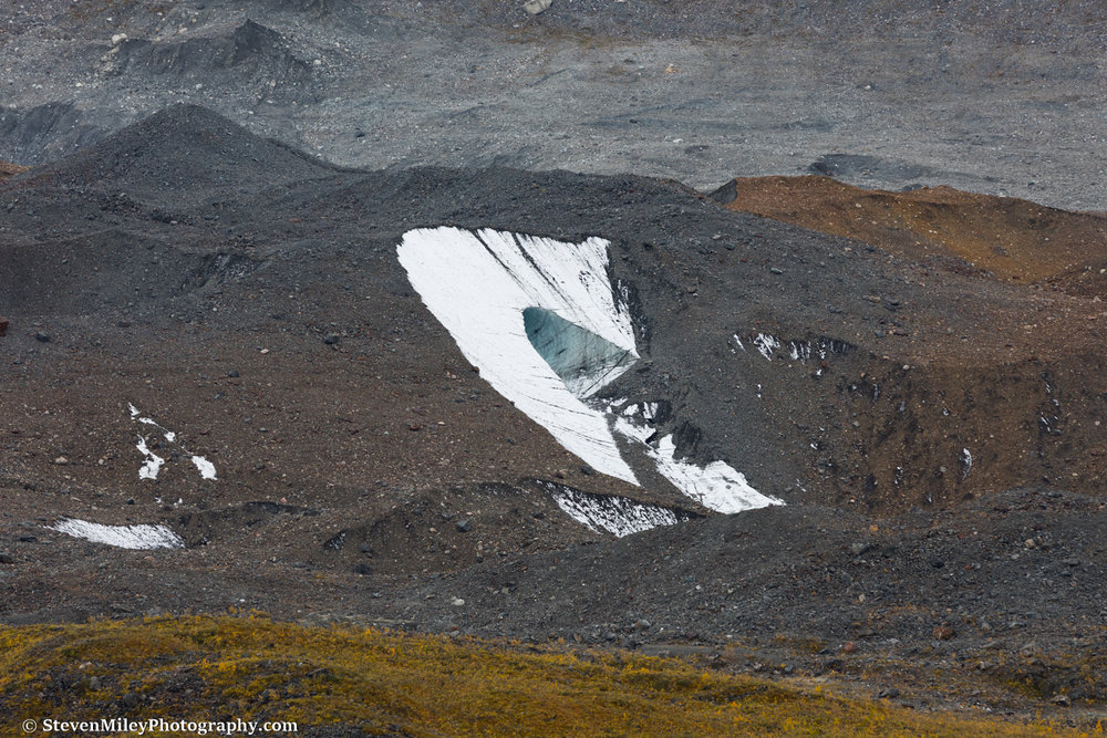 Possible ice cave formation in the moraine of Peters Glacier.