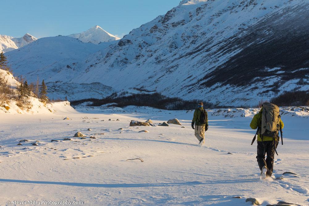 Hiking through snow to Castner Glacier.