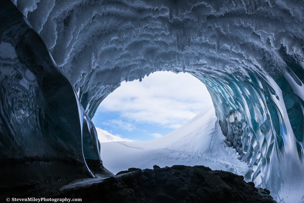 Peering out the entrance of the Canwell Glacier ice tunnel.