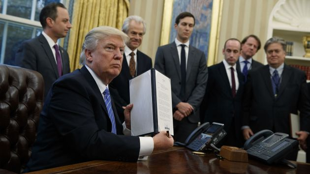 President Donald Trump reinstating the Mexico City Policy. Image source:Mother Jones, 2017.