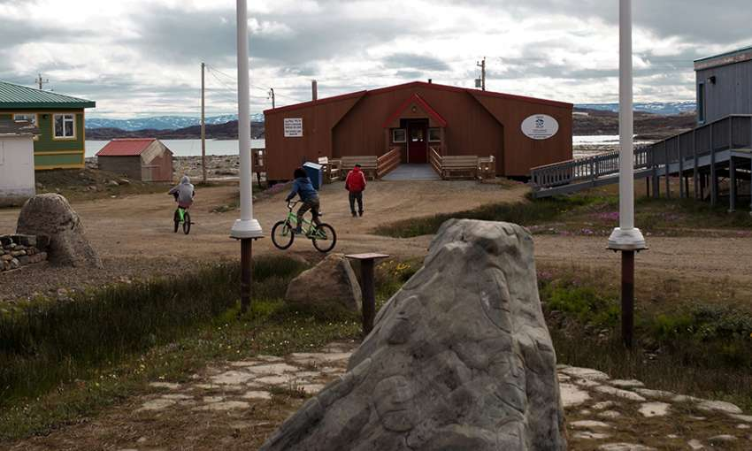 Children play outside the Elder's Qammaq in downtown Iqaluit, Nunavut. All images by Julie De Meulemeester