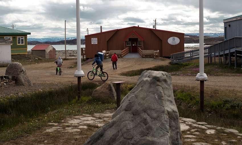 Children play outside the Elder's Qammaq in downtown Iqaluit, Nunavut. All images by Julie De Meulemeester