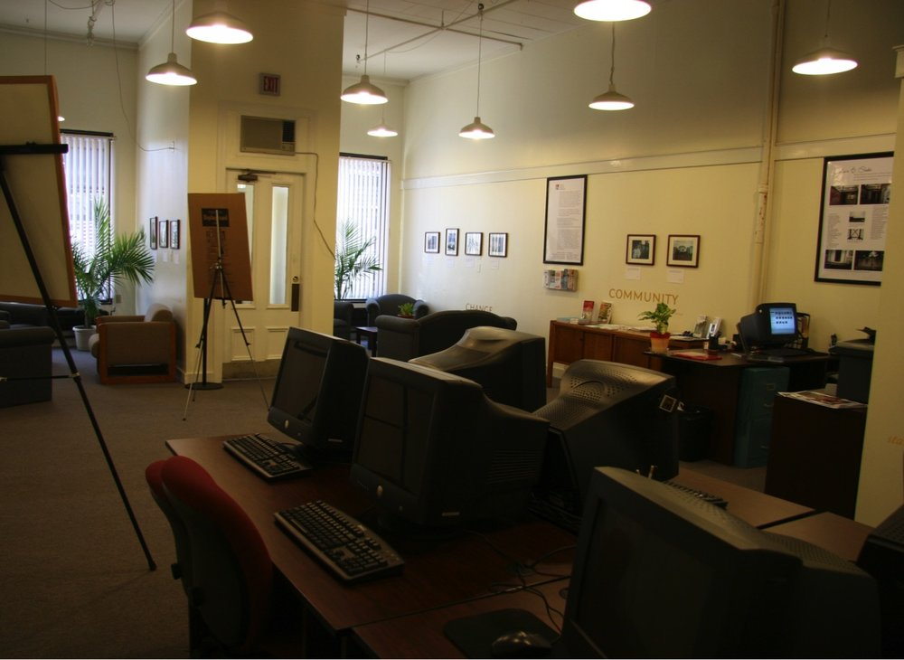 Lisbon Street center, with the computer lab in the foreground and PhotoVoice images throughout
