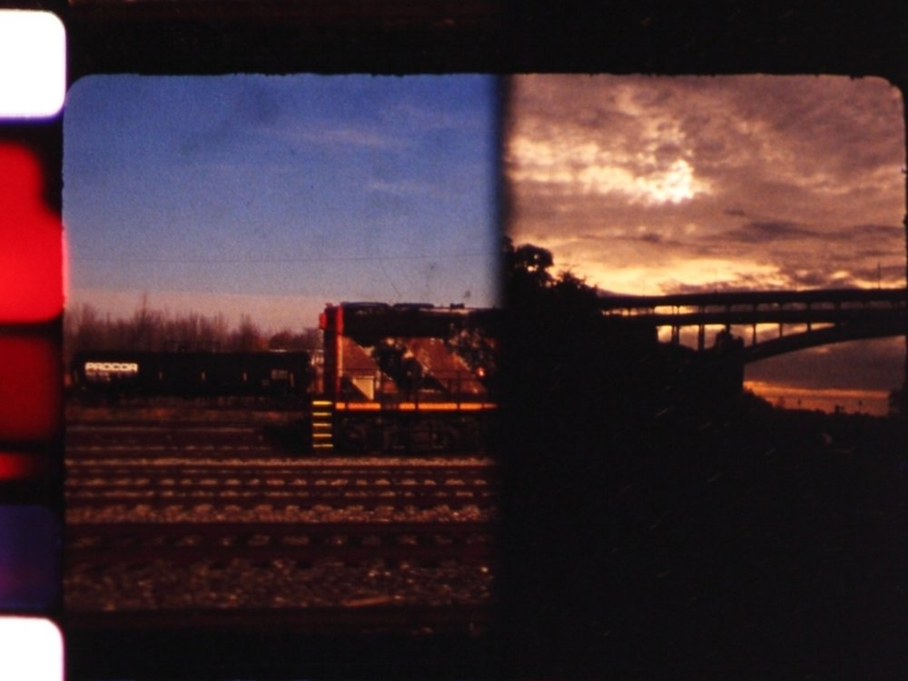 Roundtrip     Philippe Leonard   2014 / 3 minutes / USA/Canada / 16mm / silent  A diptych filmed on a journey between Montreal and New York City. My last roll of Ektachrome to commemorate an important day when two became unified in the act of giving. -PL