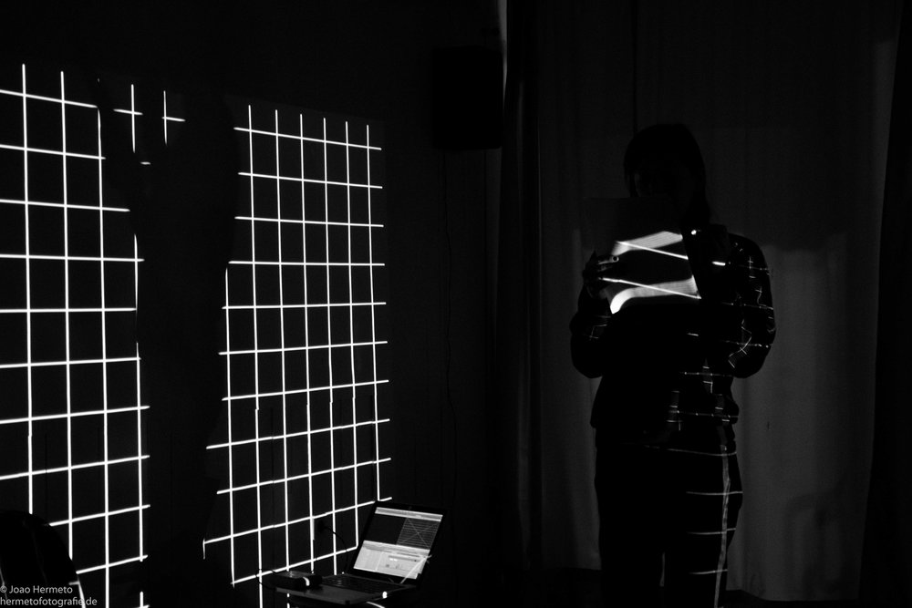 Matters of Practices/Actions/Doings     Kerstin Schroedinger  2016 / 25 minutes / performance  Through an exploration of movement and sound, rhythm and physicality in the material film, I examine the relation between sound and physicality and sound and the body of film. I analyze the technical procedure of movement of film and movement of the body, and the links between those sounds and movements in order to understand both the actual and active part of movement as a component of the film material as well as the consequences the material has for social and physical bodies. -KS