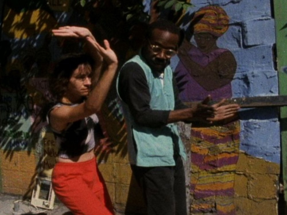 SSS     Henry Hills   1988 | 6 minutes | USA | 16mm | color | sound   SSS  is composed from footage of movement improvised on the streets of pre-gentrified East Village by Sally Silvers, Pooh Kaye, Harry Shepperd, Lee Katz, Kumiko Kimoto, David Zambrano, Ginger Gillespie, Mark Dendy, and others, painstaking synched to music previously improvised for the project at Noise New York by Tom Cora (cello), Christian Marclay (turntables), and Zeena Parkins (harp). Beauty emerging from rubble. Fantastic 80's fashions.