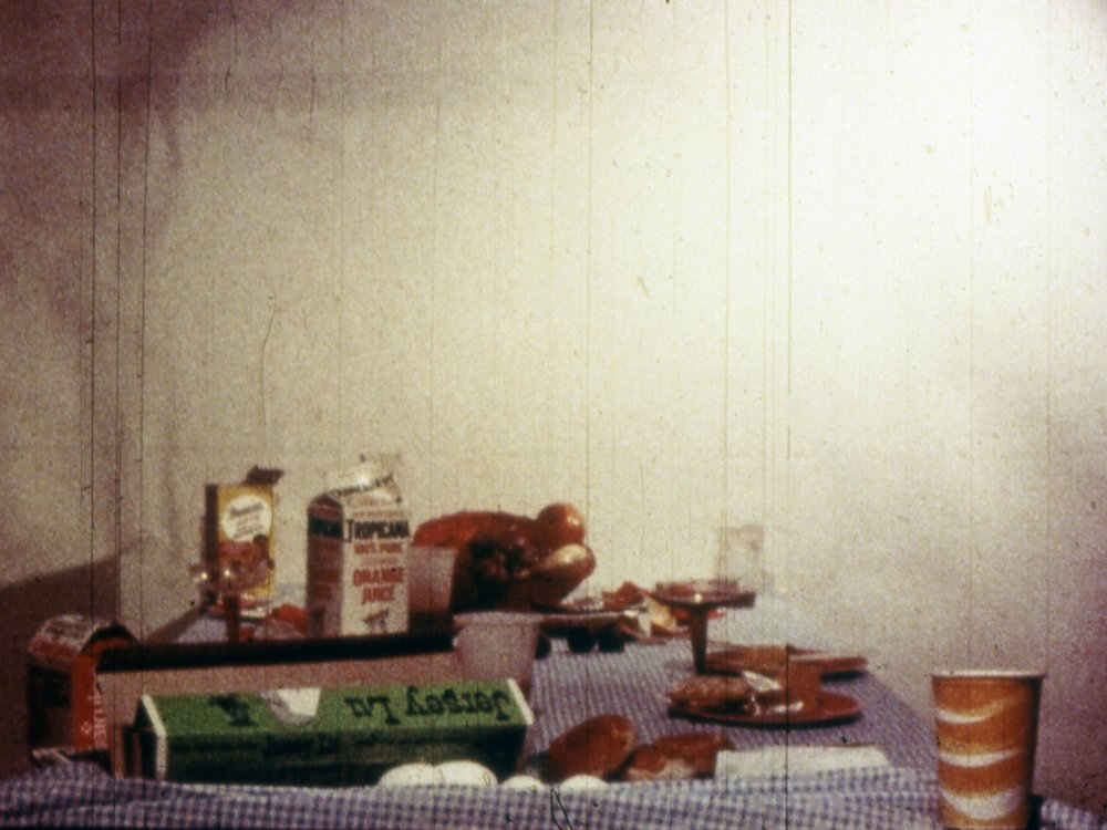 "Breakfast (Table Top Dolly)     Michael Snow   1976 | 15 minutes | Canada | 16mm | color | sound  "" Wavelength  before breakfast. A continuous zoom traverses the space of a breakfast table, serving as a grand metaphor for indigestion."" -Deke Dusinberre"