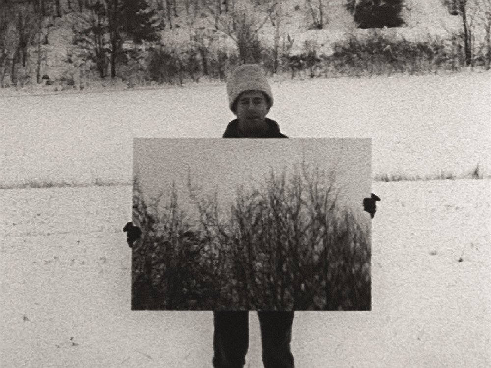 Mirror Robert Morris 1971 | 9 minutes | USA | 16mm | b&w  | silent Morris, in a winter landscape, holds a mirror to nature, and to the camera.