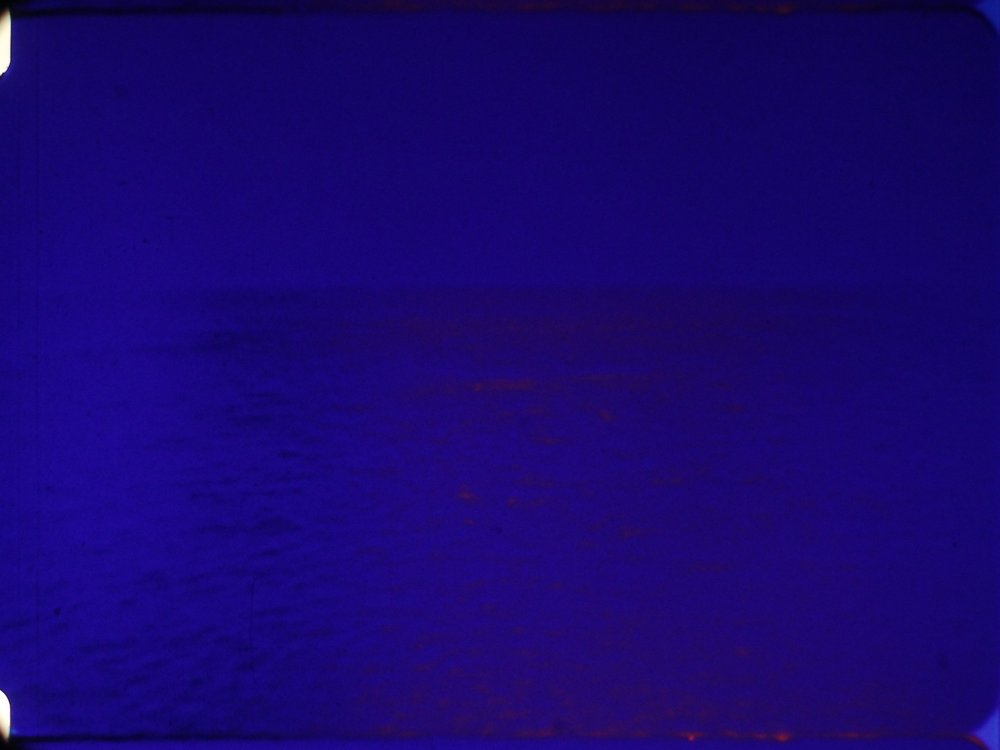 Elli     Esther Urlus     2016 | 8 minutes | Amsterdam | 16mm | color | sound  Calm shots of a seascape also examine optical colour mixing using various flicker effects. Shot on the exact spot in Greece that marked the country's entrance into World War II. -EU