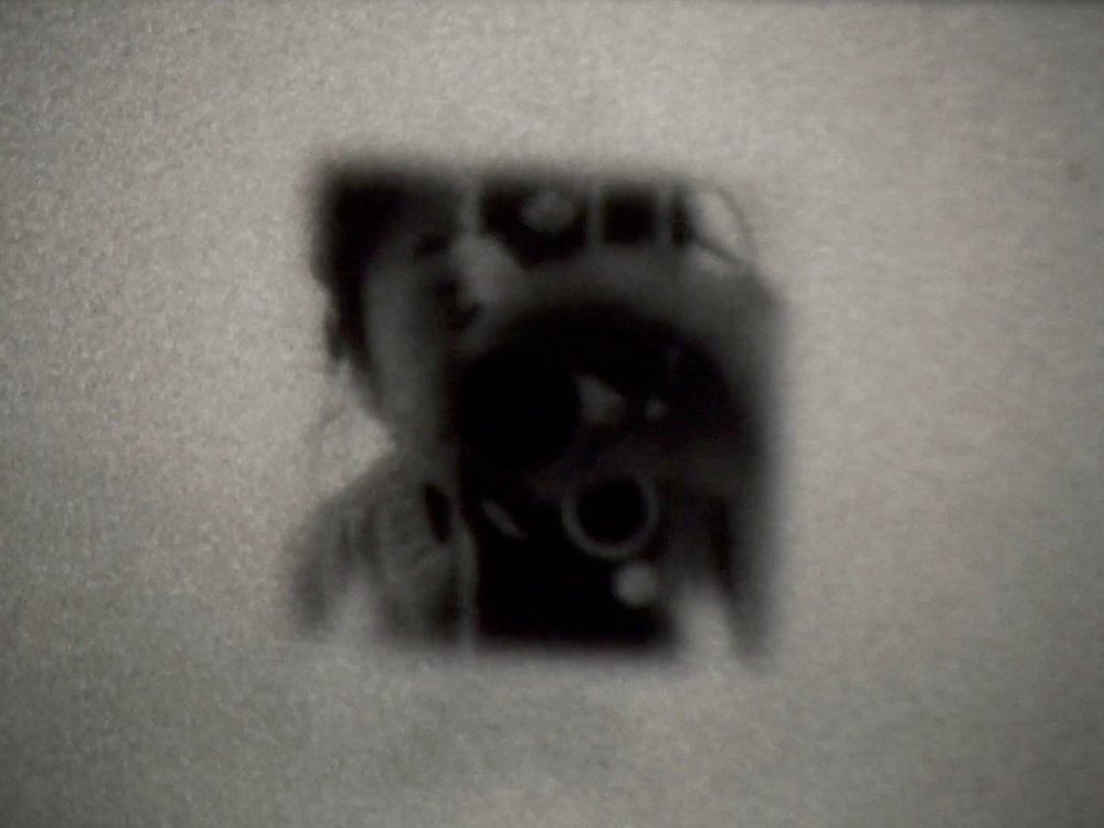 Studio Sunrise     Kioto Aoki   2018 | 3 minutes | USA | 16mm | b&w | silent  A reflected self-portrait imitating celestial movements of the sun. -KA