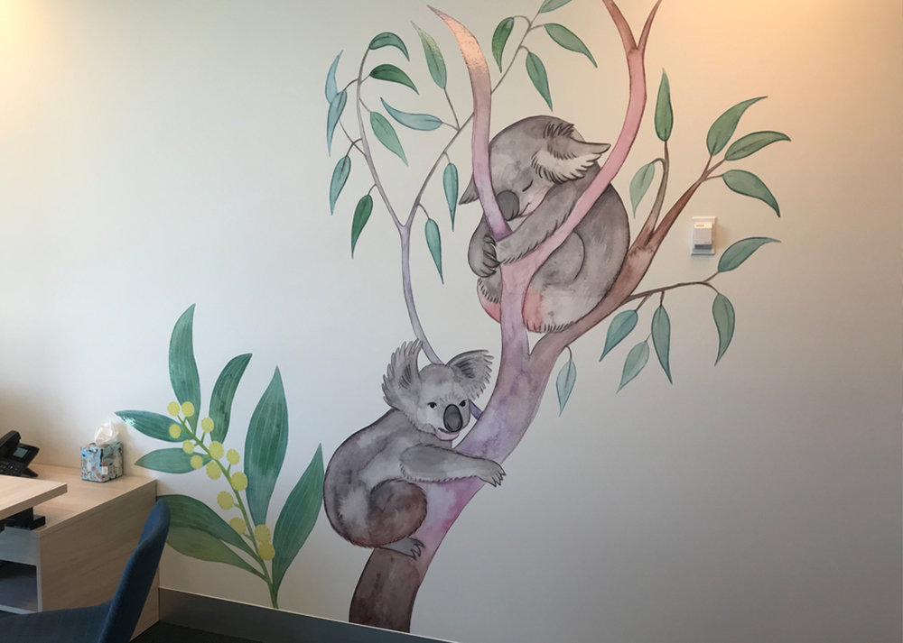 Koalas and wattle flowers in one of the consultation rooms.
