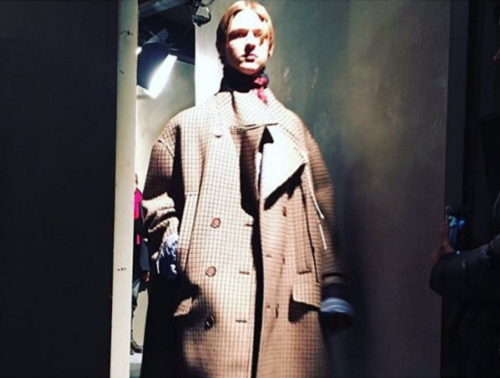 Plaids were a centre feature of Simon's collection seen throughout the loose outerwear. Photo via Benjamin J Carr.