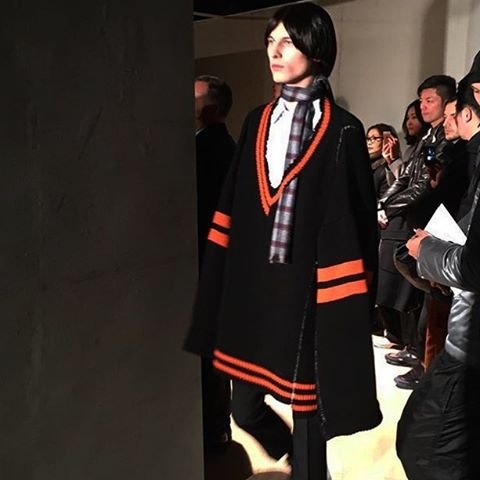Plaid scarves appeared in shortened form tied around the model's necks. Photo via Salvatore Congiu.