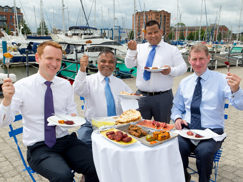 From left, Tom Watson, Tapan Mahapatra, Mukesh Tirkoti and David Donkin raise their forks to the forthcoming opening of Tapasya @ Marina overlooking Hull Marina.