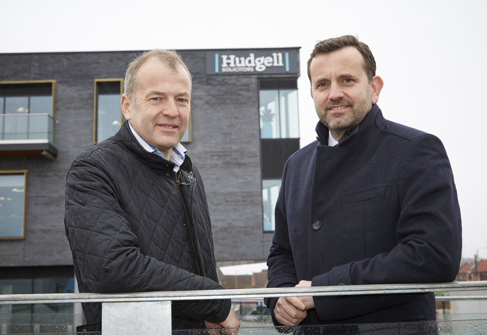 Neil Hudgell and Dominic Gibbons in front of Hudgell Solicitors' impressive new offices at the @TheDock development – yet another major investment as part of the regeneration of Hull's Fruit Market area.