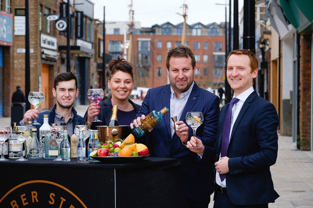 From left, Craig Heads, Charlotte Bailey and Lee Kirman from Humber Street Distillery Co raise a toast to their new venture with Wykeland Group's Tom Watson.