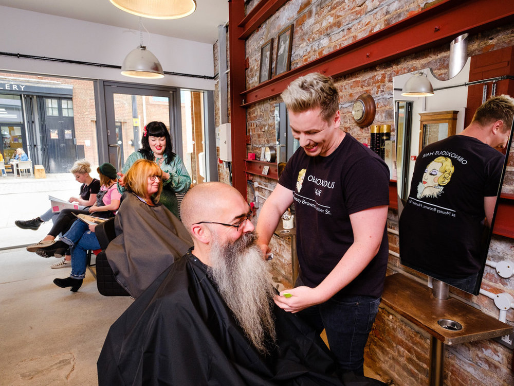 Stylist TJay Railton, front, and owner Sarah Clayton with customers Gerard Baker and Jacquie Sims in Hull's first subculture hair salon, Mousey Brown's, the latest quirky addition to the diverse range of entrepreneurial businesses in the city's Fruit Market waterside quarter.