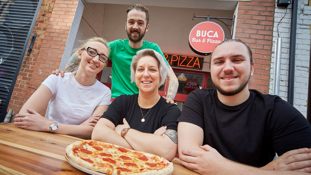 Buca di Pizza team members, from left, Waitress Charlotte Harrington, Head Chef Tom Lynch, Supervisor Kerrie Marsh and Chef Aaron Crossland outside the new pizzeria and bar in Hull's Fruit Market.