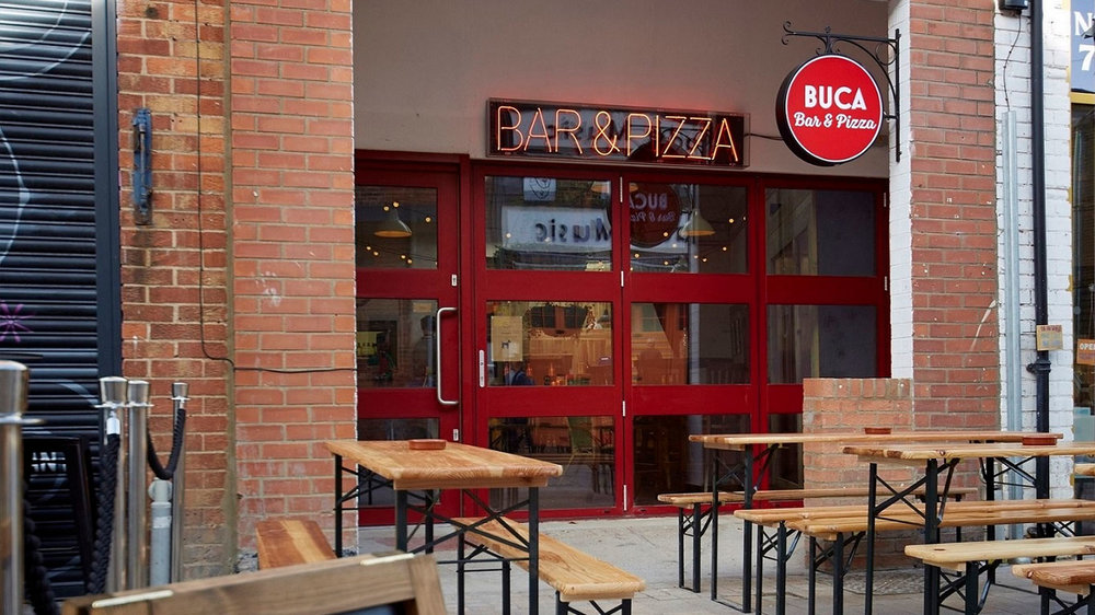 The opening of Buca di Pizza has created 15 full-time and part-time jobs.