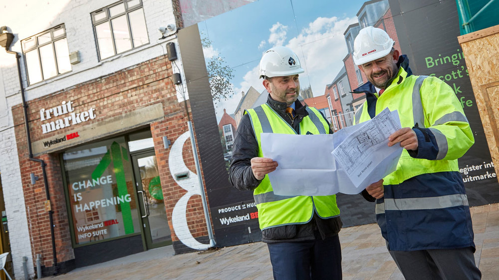 Dominic Gibbons, left, of Wykeland Group, and Richard Beal, from Beal Homes, examine plans for the £17m residential development on land behind Humber Street in the heart of the Fruit Market waterside quarter.