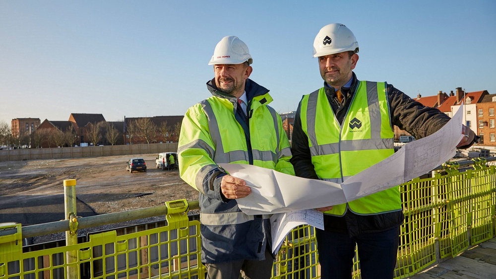 Richard Beal, left, from Beal Homes, and Dominic Gibbons of Wykeland overlooking part of the site that will become a high-quality development of 101 mews-style homes in the Fruit Market creative and cultural district.