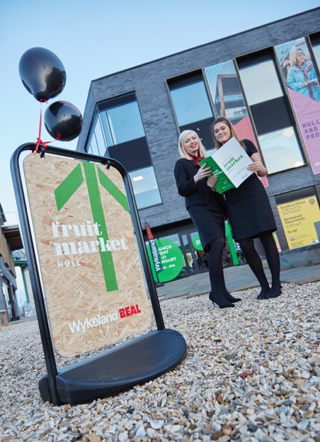 Sales Assistants Emily Douglas, left, and Georgia Slade outside the venue for the Fruit Market residential development launch.