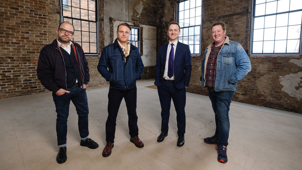 Tom Watson from Wykeland Beal, second from right, with J. Johnson owners, from left, Chris Eastaugh, Jason Gittens and Dan Robinson in the former fruit and veg warehouse in Humber Street which has been comprehensively renovated by Wykeland Beal in a £250,000 project.