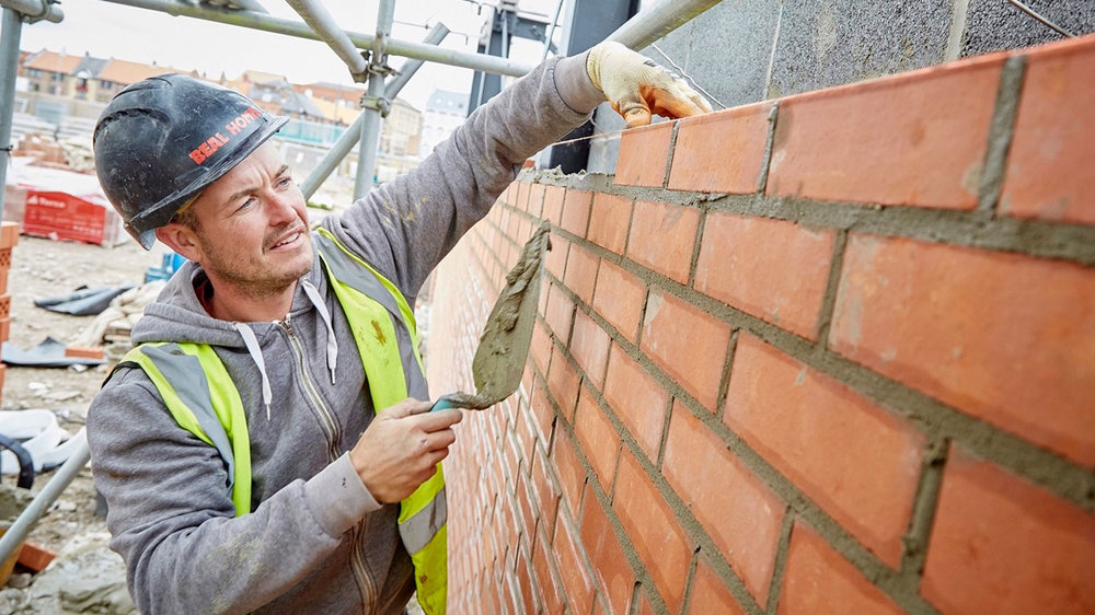 Bricklayer Mike Burley at work on the Fruit Market development. At peak times up to 100 construction workers will be on site.