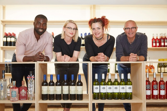 Owners Phil Benson, left, and Jonathan Elvidge with Sales Assistant Beth Hall, second left, and Manager Katherine Gregory inside The Store on Pier Street, which will stock speciality wines and spirits, as well as locally-sourced food items and daily essentials.