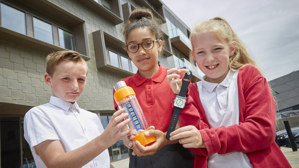 Chiltern Primary pupils, from left, Tom Nundy, Tianni Lawrence and Amelia Stanley with two of the innovative products developed during the Go See! Go 3D! project commissioned by Fruit Market developer Wykeland Beal.