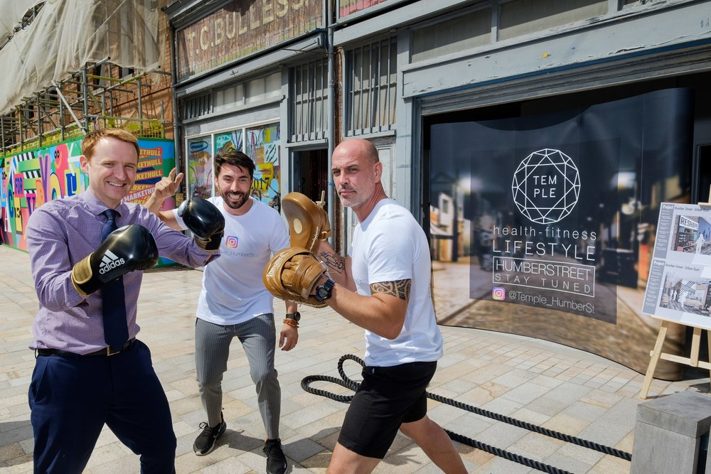 Personal trainer Dale Robinson, right, puts Wykeland Beal's Tom Watson through a boxercise session watched by business partner Riccardo Seaton.