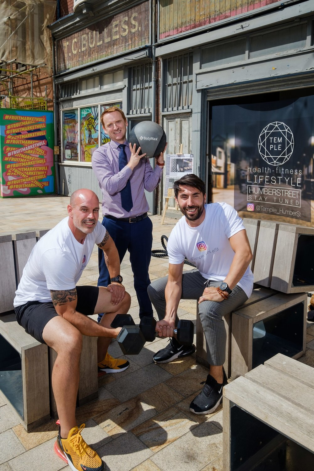 Business partners Dale Robinson, left, and Riccardo Seaton, right, with Wykeland Beal's Tom Watson, outside the building in Hull's Fruit Market that will become The Temple @ Humber Street.