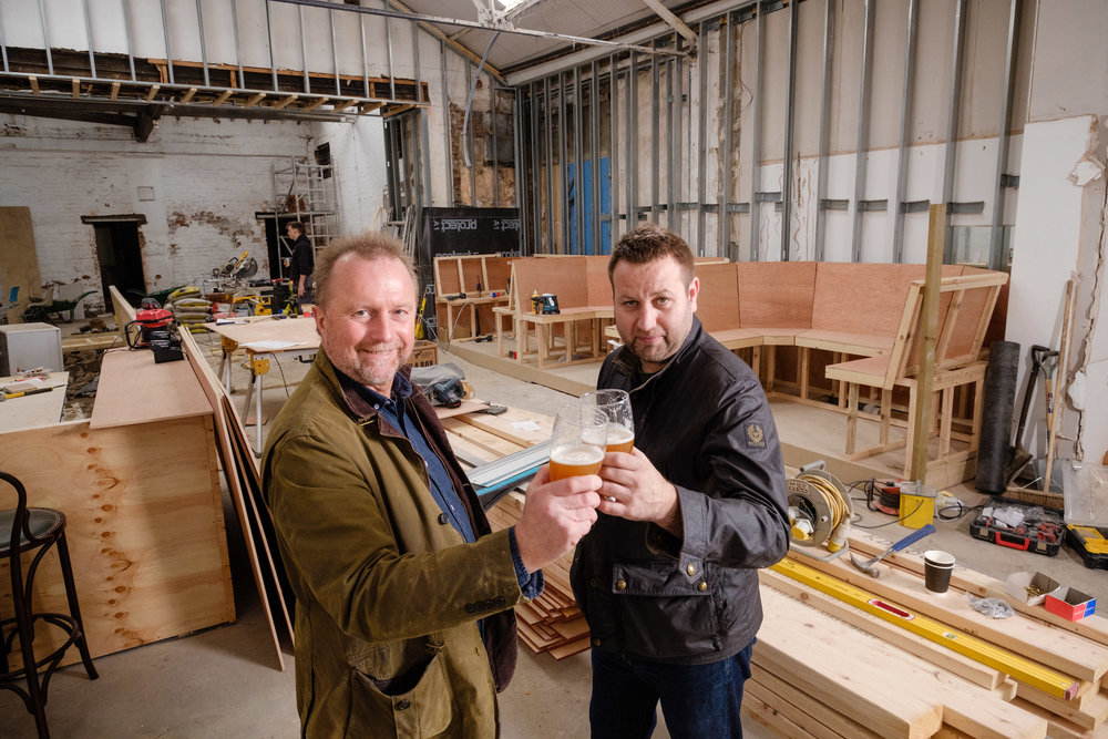 Guy Falkingham (left) and Lee Kirman raise a glass to their new venture.