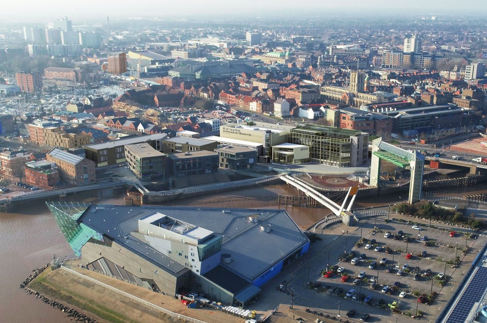 An aerial view of the Fruit Market area and waterfront, showing how the latest development including Arco's new head office will look. The image also shows buildings recently given planning approval as part of the completion of the @TheDock tech campus.