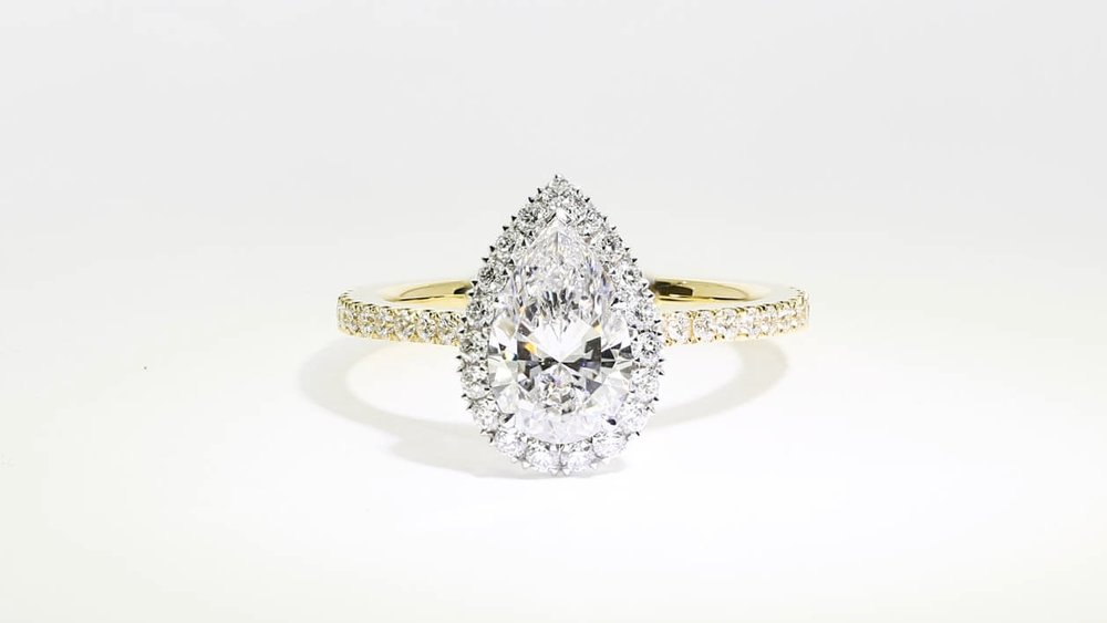 Pear diamond, delicate halo and 18ct yellow gold - perfection in one of Queensmith's bespoke designs