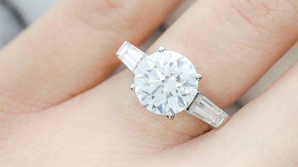 A 4.11ct centre diamond