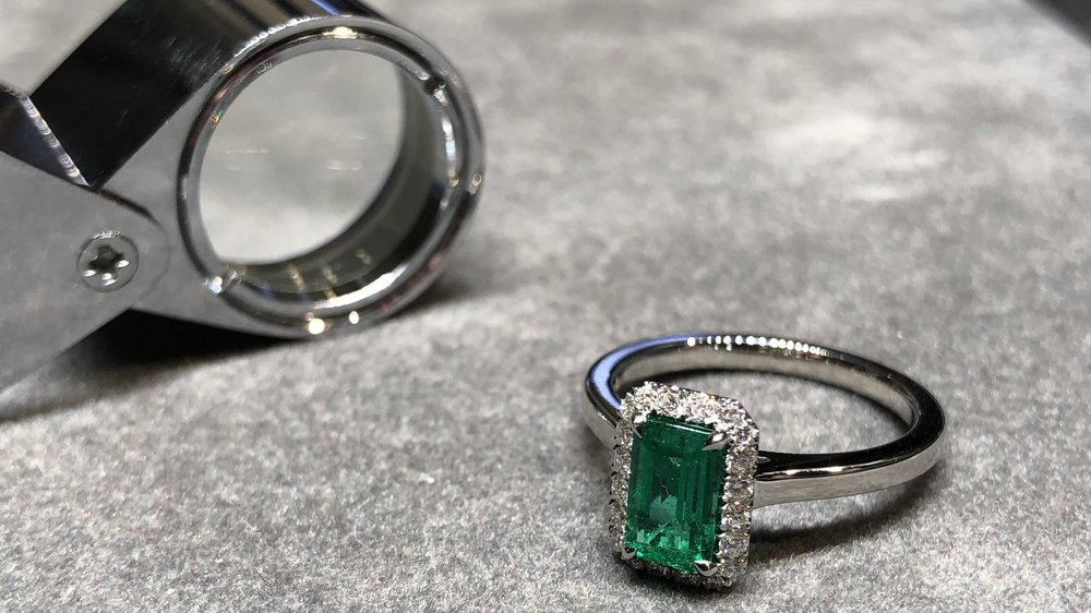 One of our emerald  engagement rings  being inspected before handing over to the client