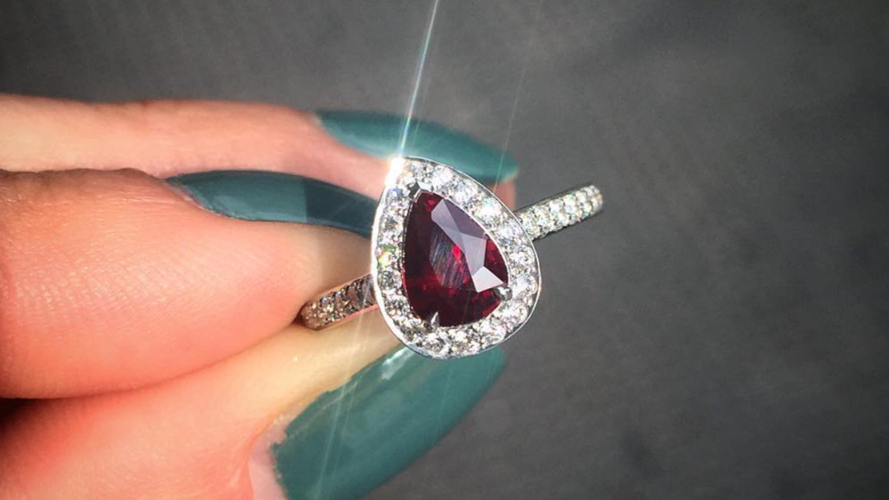A bespoke Queensmith design, featuring a pear ruby and halo of diamonds