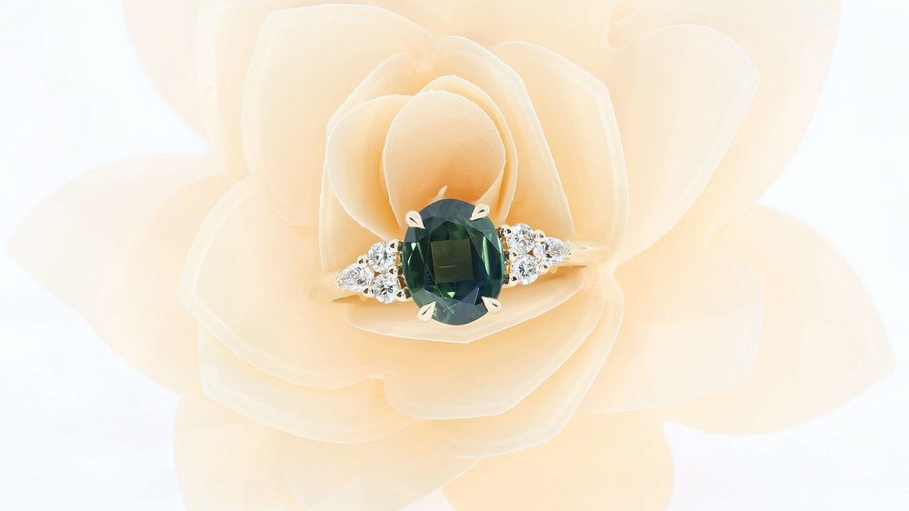 A Bespoke Engagement Ring, Using A Green Centre Sapphire, And Round And  Pear Shoulder