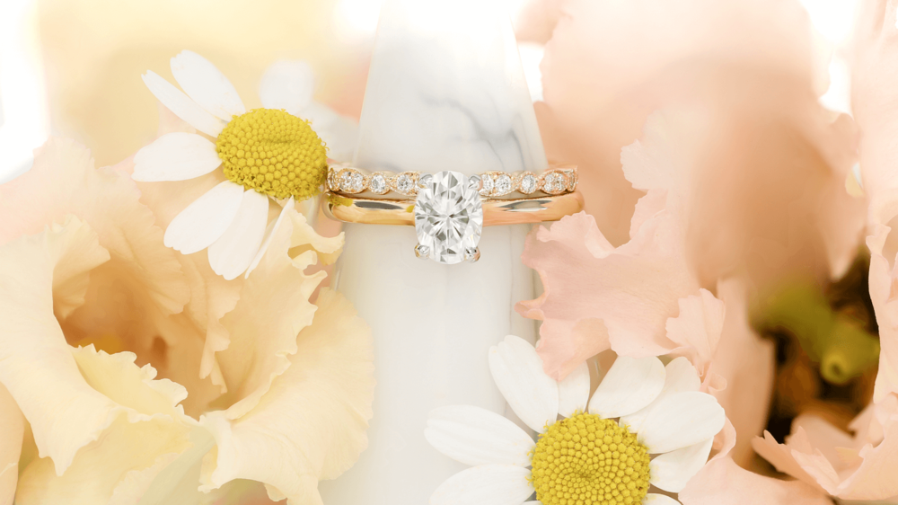 Queensmith's  Oval Tierney  engagement ring and  Montez  wedding band, with flowers by Bloom & Wild