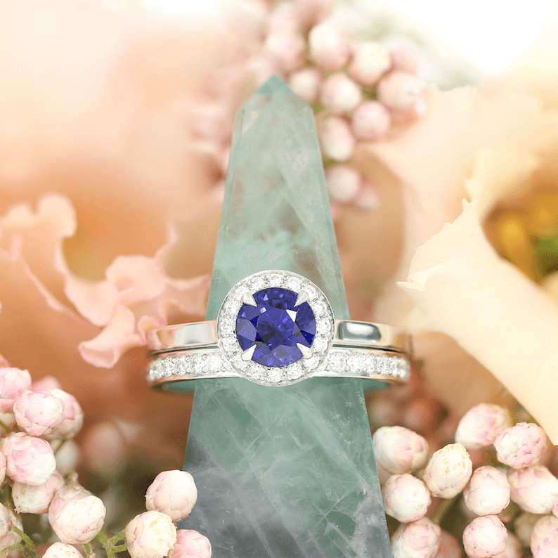 The Faye sapphire engagement ring and  Channel Set  wedding ring, with flowers by Bloom & Wild