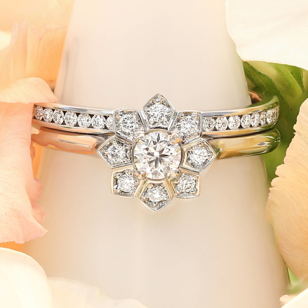 Platinum Flower Halo Engagement Ring & Channel Set Diamond Wedding Band