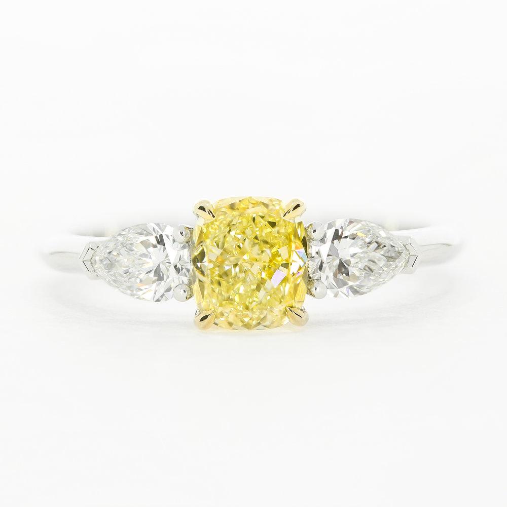 A bespoke take on the  Lamar  trilogy engagement ring, using a yellow cushion cut diamond