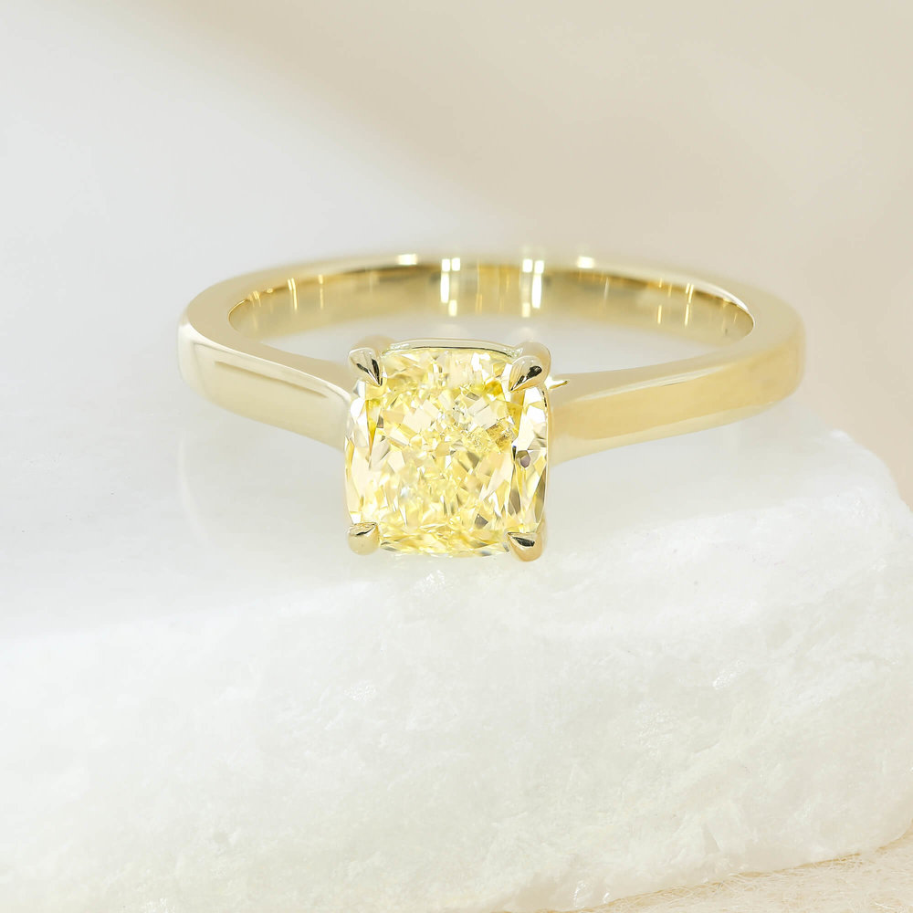A yellow diamond  solitaire engagement ring
