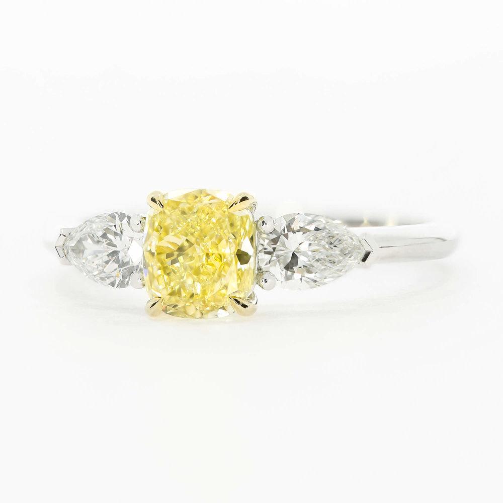 A custom take on the  Lamar design , featuring a yellow cushion cut diamond and platinum band