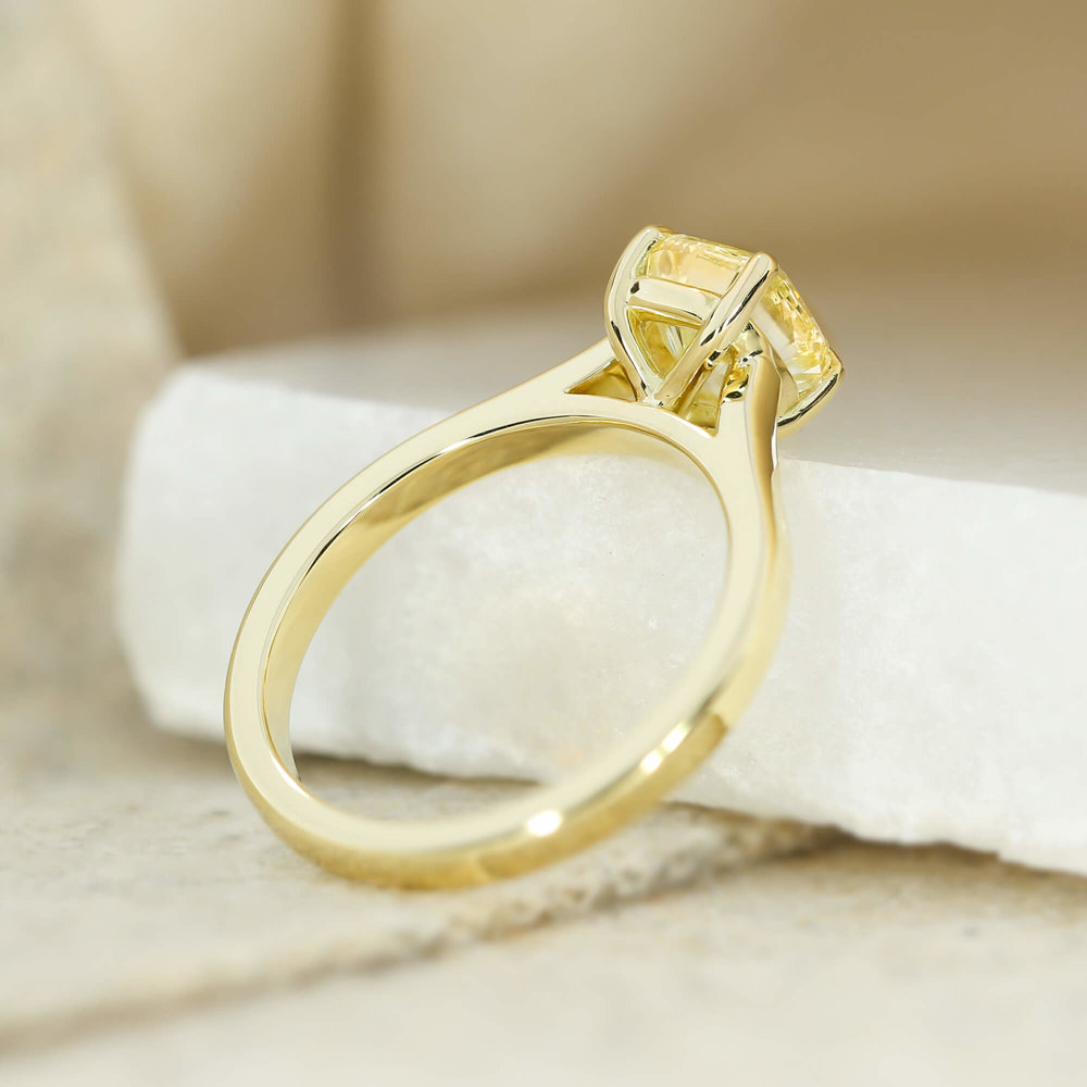 A  bespoke design , featuring a yellow diamond and matching 18ct yellow gold band