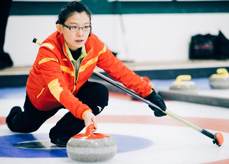 Img Credit: Wang Bingyu competing at the World Curling Tour, Basel
