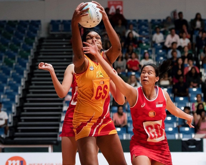 Melody Teo of Singapore tries in vain to stop Sri Lankan player Tharjini Sivalingam