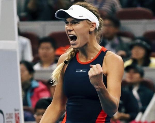 Caroline Wozniacki reacts while competing against Anastasija Sevastova. Photo: AP